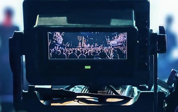 Camera Filming Large Crowd